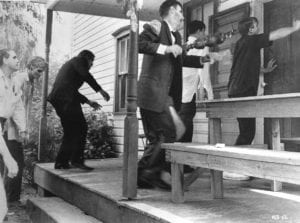 Zombies attacking the farmhouse in Night of the Living Dead