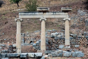 Three columns in ruins at Ephesus symbolizing the crumbling of reactionary edifice