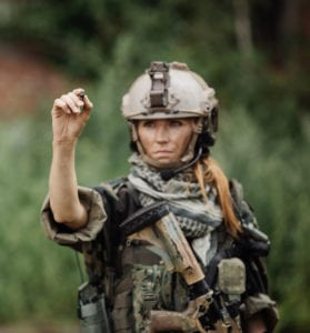 Young American woman in full military combat uniform