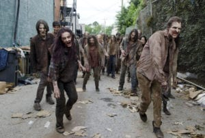 A horde of zombies in an alley