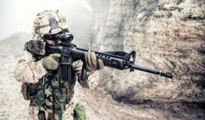 Soldier shooting an assault rifle