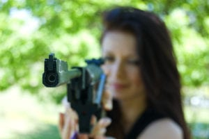 Woman pointing a rifle