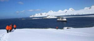 Photo of hikers and the ship in Antarctica