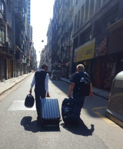 Photo of Sergio and Terry hauling luggage
