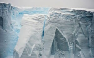Photo of a glacier that is slowly calving or breaking parts off into the ocean