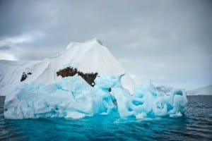 Photo of a honeycombed iceberg.
