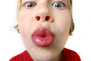 Photo of a child offering a kiss