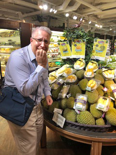 Photo of Tim eating a Durian fruit