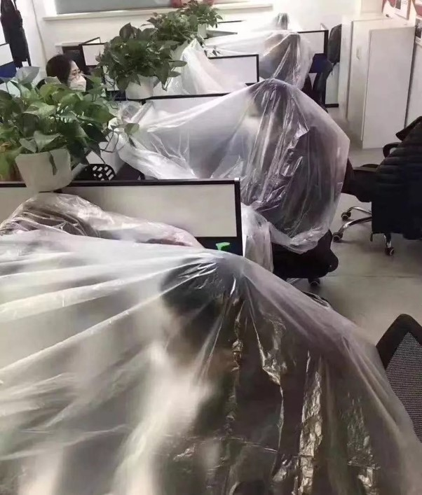 Workers encased in plastic