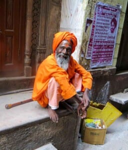 Photo of a street beggar in orange
