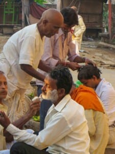 Photo of barbers working outdoors in Baranasi