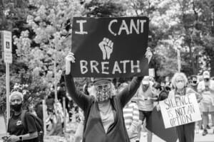"Protester with ""I Can't Breathe"" sign"