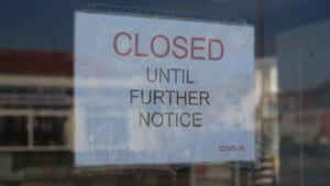 Sign in store window: closed until further notice