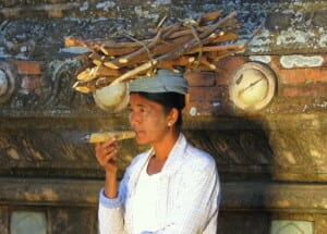 Photo of a Burmese woman smoking a fat cigar