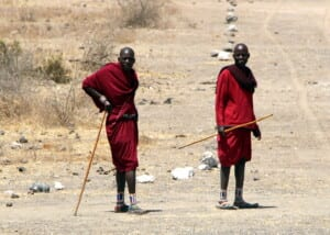 Photo of two Masai men wearing red robes