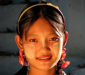 Photo of a girl with face paint in Myanmar