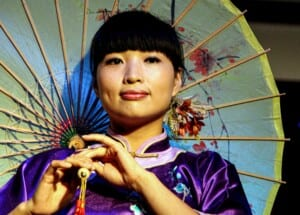 Photo of a Chinese woman with an umbrella