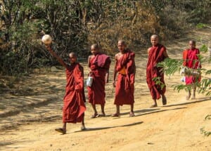 Photo of five red-robed monks with a soccer ball